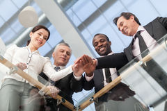 Business people joining their hands. Business team joining their hands at office. Bottom View Royalty Free Stock Photography