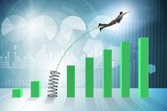 The business people jumping over bar charts. Business people jumping over bar charts Royalty Free Stock Photography