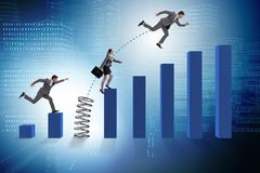 The business people jumping over bar charts. Business people jumping over bar charts Royalty Free Stock Photo