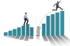 The business people jumping over bar charts. Business people jumping over bar charts Stock Photo