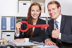 Business people with key holding Stock Image