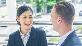 Business people lady and caucasian man talk together and feeling. The business people lady and caucasian men talk together and feeling happy stock image