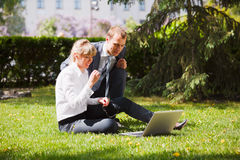 Business people with laptop Stock Images