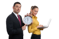 Business people with laptop and alarm clock Stock Photography