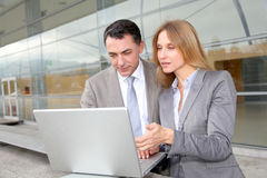 Business people with laptop computer Stock Photo