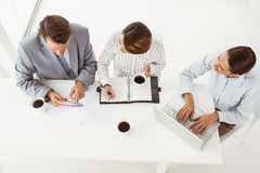Business people with laptop and diary at office Royalty Free Stock Image