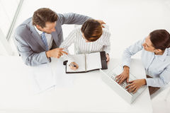 Business people with laptop and diary at office Royalty Free Stock Photography