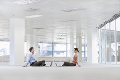 Business People With Laptops In Empty Office Space Stock Photography