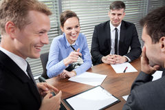 Business people laughing during business meeting Stock Images
