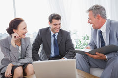 Business people laughing while having a meeting Royalty Free Stock Image