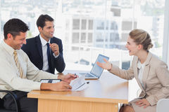 Business people laughing with interviewee Stock Photos