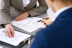 Business people and lawyer discussing contract papers sitting at the table, closeup view.  Royalty Free Stock Photo