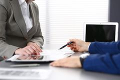 Business people and lawyer discussing contract papers sitting at the table, closeup view.  Stock Image