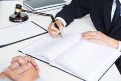 Business people and lawyers discussing contract papers sitting a Stock Images