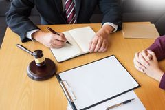 Business people and lawyers discussing contract papers sitting a. T the table. Concepts of law, advice, legal services Royalty Free Stock Photography
