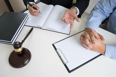 Business people and lawyers discussing contract papers sitting a. T the table. Concepts of law, advice, legal services Stock Images