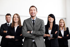 Business people with leader Royalty Free Stock Photo