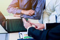 Business people learning the finance graph working in office. Stock Photo
