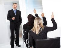 Business people at the lecture asking questions Stock Photos