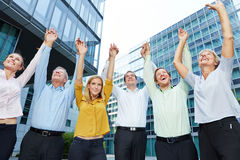 Business people lifting arms up together Stock Photo