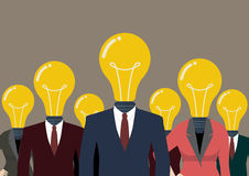 Business people with a light bulb head Royalty Free Stock Images