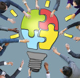 Business People with Light Bulb Jigsaw Symbol Stock Image