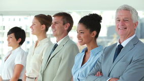 Business people in line looking away Stock Images