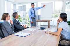 Business people listening during a meeting Royalty Free Stock Photos