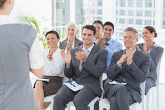 Business people listening during meting Stock Photography
