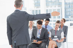 Business people listening during meting Stock Images