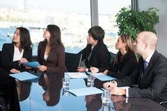 Business people listening to presentation Stock Image