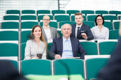Business People Listening To Speaker In Lecture Hall Stock Photo