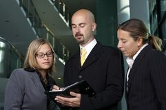 Business people looking. Young business team is looking on schedule Royalty Free Stock Photos