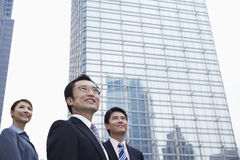 Business People Looking Away In Front Of Building Royalty Free Stock Image