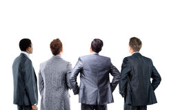Business people looking at a banner. Four business mans from the back - looking at something over a white background royalty free stock photo
