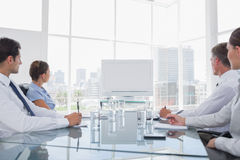Business people looking at a blank whiteboard Royalty Free Stock Photography