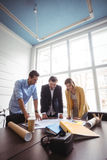 Business people looking at blueprint Royalty Free Stock Photo