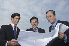 Business People Looking At Blueprint Stock Photos