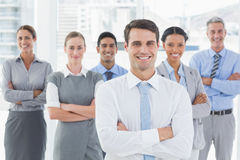 Business people looking at camera with arms crossed Royalty Free Stock Image