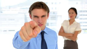 Business people looking at camera. In the office stock footage