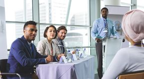 Business people looking at camera in a business seminar royalty free stock photography
