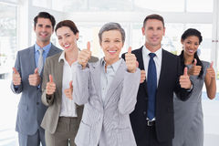 Business people looking at camera thumbs up Royalty Free Stock Photos