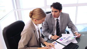 Business people are looking at charts. In a bright office stock footage