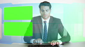 Business people looking at chroma key screens Stock Photo