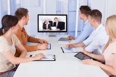 Business people looking at computer monitors in office royalty free stock image