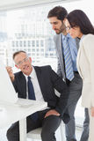 Business people looking at a computer Royalty Free Stock Photography