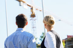 Business people looking at a crane Royalty Free Stock Photos