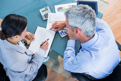 Business people looking at documents with graphics. In office Royalty Free Stock Photo