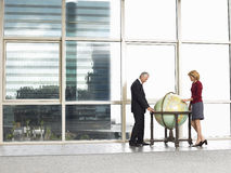 Business People Looking At Globe In Office Royalty Free Stock Image