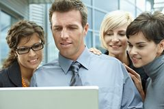 Business people looking at laptop Royalty Free Stock Image